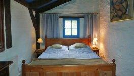 Schlafzimmer_im_Ferienhaus_Merlin
