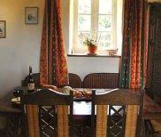 Bon Appétit - Ferienhaus Speisetisch mit Gartenblick